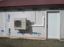 Heat pump installed on exterior wall of grow room