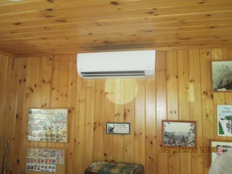 Entryway heat pump on wall