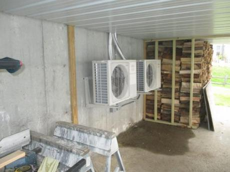 Outdoor units next to firewood