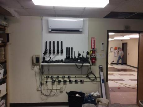 Pump above storage shelf